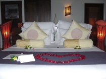 The bed was decorated with a lovely heart shape of rose leaves