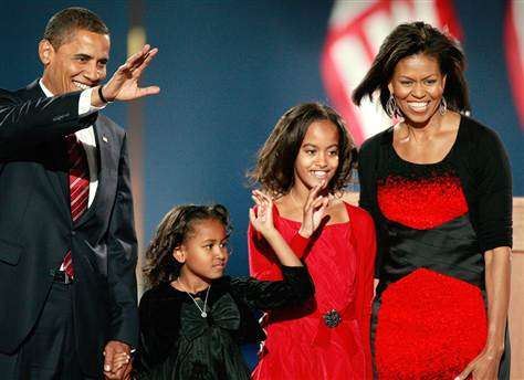 President-elect Barack Obama walks on stage at his victory celebration in Chicago with his wife, Michelle, and their daughters, Malia and Sasha.