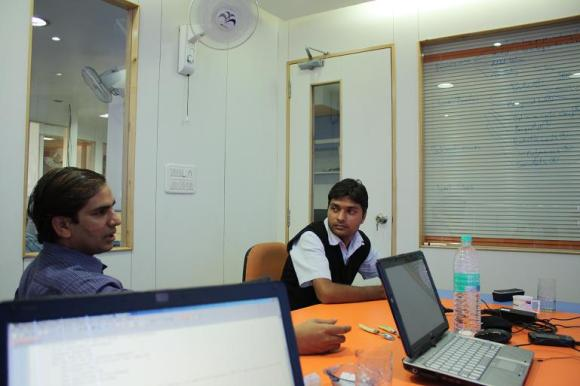 Naren and Abhay are discussing if it's possible to implement the page cache as a separate application